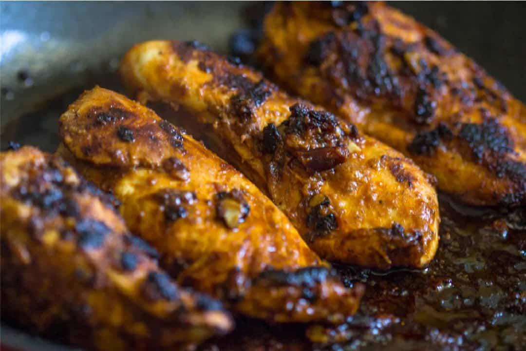 Grilled chicken in a sticky dark sauce