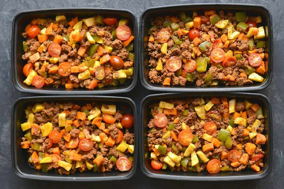 Sweet Potato and Chorizo Hash in four meal prep containers