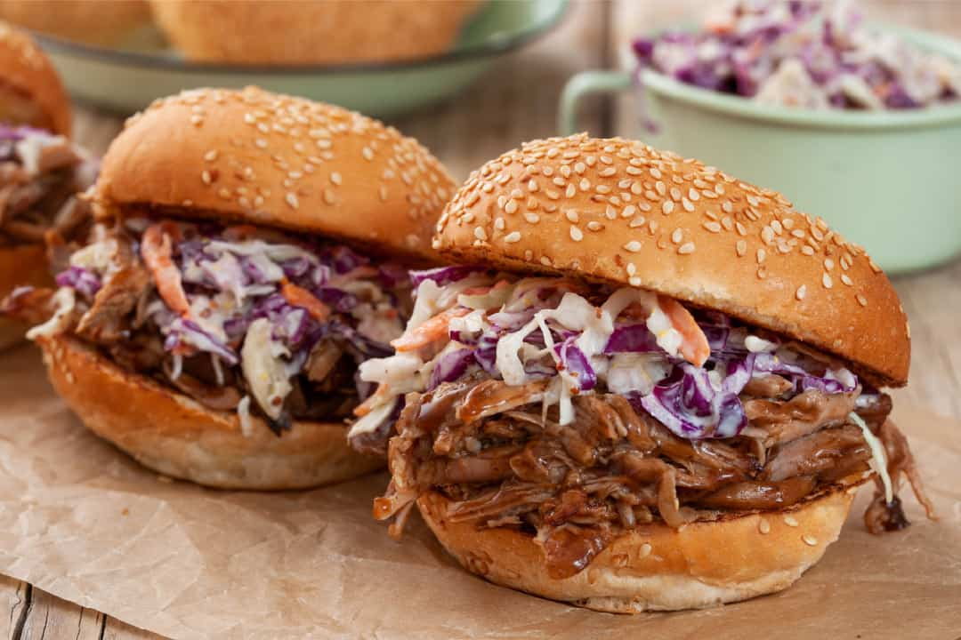 Pulled pork with slaw in a burger bun