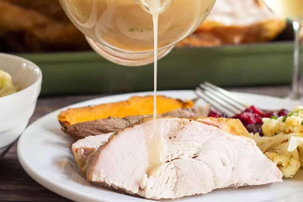 Gravy being poured on to turkey breast