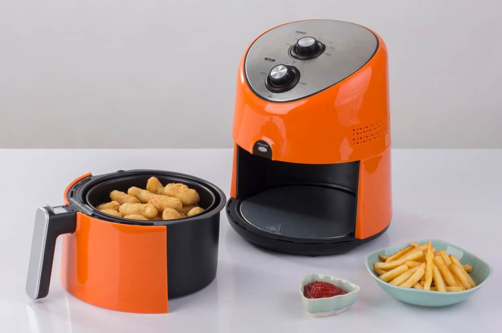 Air fryer with nuggets inside