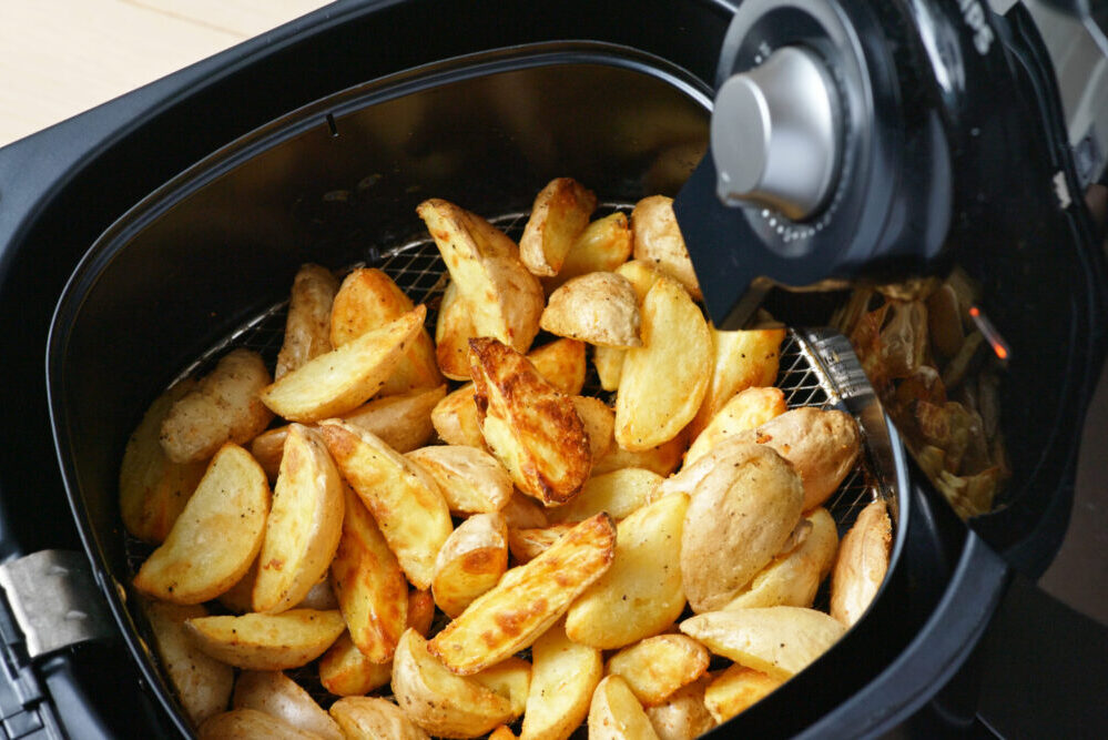 Air fryer with potato wedges