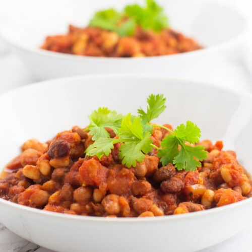 Slowed cook bean chilli in a bowl with coriander