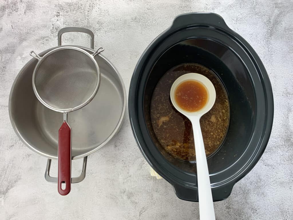 Leftover stock in the crock pot and a large pot