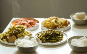 Five side dishes including rice and roasted vegetables
