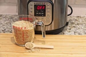 Instant Pot Duo with rice in a measuring jug