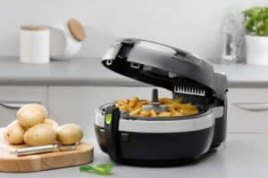 Commercial air fryer filled with potatoes