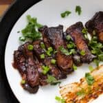 Korean BBQ ribs on a plate with sticky bbq sauce