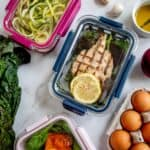 Tuna steak, zucchini noodles and salad in meal prep containers