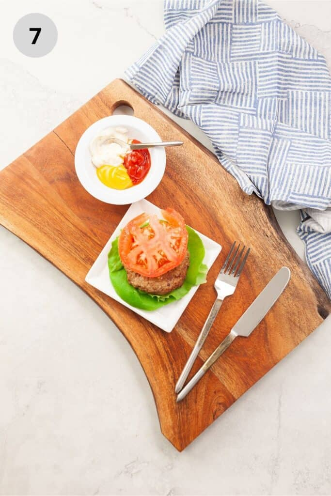 Adding lettuce and tomato to a turkey burger